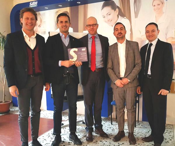 Andrea Cossu e Massimiliano Fadin ricevono il riconoscimento  da Sutter